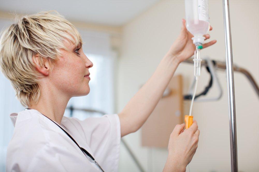 doctor adjusting infusion