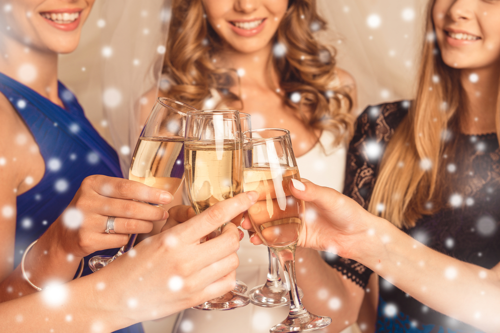 women toasting with champagne at a holiday party